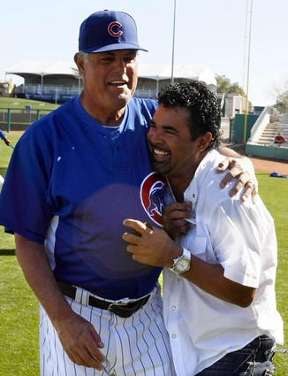 Lou Piniella and Ozzie Guillen share a laugh before Saturday's exhibition, in which the Cubs pounded the Sox 13-0/